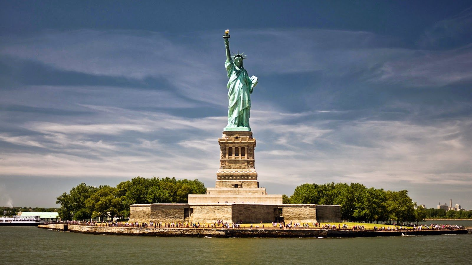 Statue of Liberty and Liberty Island full of tourists